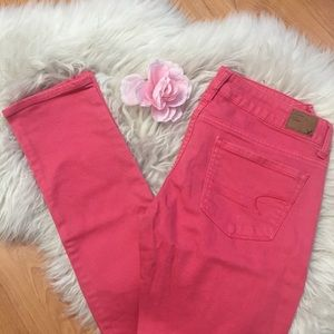 AEO, skinny stretch jeans, deep coral pink.